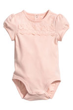 Bodysuit with a lace yoke - Powder pink -  | H&M CN 1