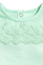 Bodysuit with a lace yoke - Light green -  | H&M 2