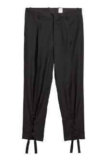 Wool trousers with lacing