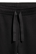 Wide joggers - Black - Men | H&M 2