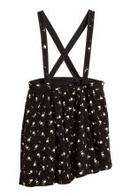 Skirt with straps - Black/Small floral - Kids | H&M 1