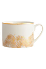 Printed porcelain mug - White/Palm leaf - Home All | H&M CN 2