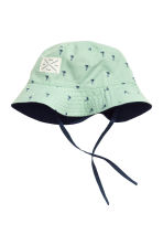 Reversible sun hat - Mint green/Palms - Kids | H&M 1