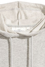 Hooded top with raw edges - Light grey marl - Ladies | H&M CN 3