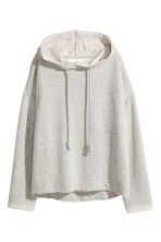 Hooded top with raw edges - Light grey marl - Ladies | H&M CN 2