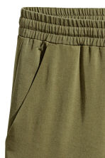 Wide lyocell trousers - Khaki green - Ladies | H&M 3
