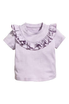 Top with a frilled yoke