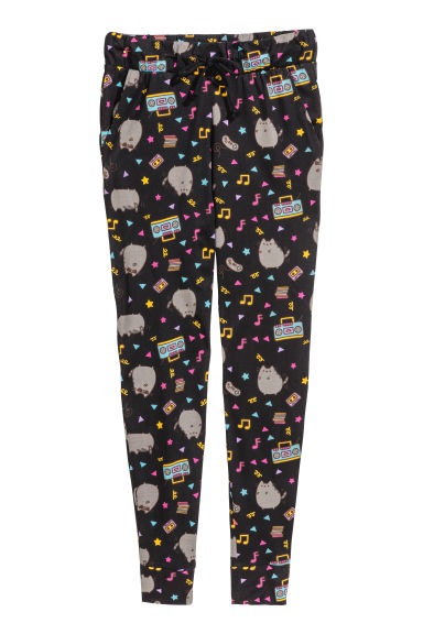 Patterned jersey joggers - Black/Cats - Ladies | H&M CN 1