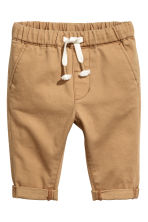 Pull-on chinos - Dark beige - Kids | H&M 1