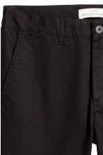 Chinos in cotone Skinny fit - Nero - UOMO | H&M IT 4