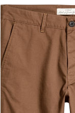 Cotton chinos Skinny fit - Dark camel - Men | H&M CN 4