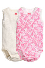 2-pack sleeveless bodysuits - White/Floral - Kids | H&M 1