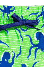 Patterned swim shorts - Neon green/Octopus - Kids | H&M CN 2