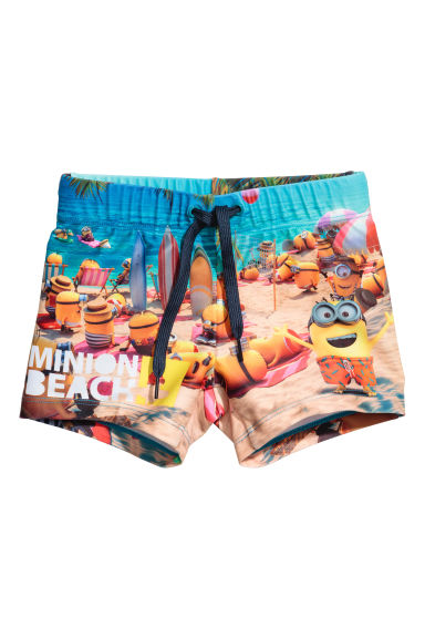 Printed swim shorts - Beige/Minions - Kids | H&M 1