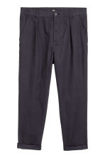 Pleat-front chinos Relaxed fit - Dark blue - Men | H&M GB 2