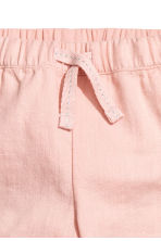 Pull-on cotton trousers - Powder pink/Cat - Kids | H&M 2