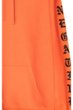 Hooded top with a print motif - Orange - Men | H&M 3