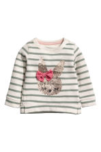 Appliquéd sweatshirt - Beige/Green striped - Kids | H&M CN 1