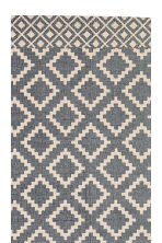 Patterned cotton rug - Natural white/Dark blue - Home All | H&M IE 2