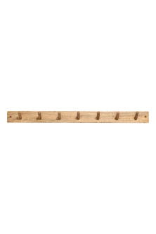 Wooden peg rail