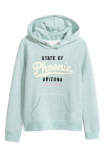 Hooded top with a motif - Mint green -  | H&M CN 1