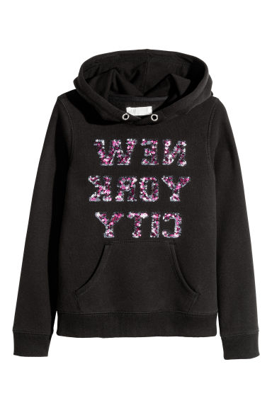 Hooded top with a motif - Black - Kids | H&M CN