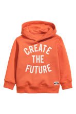 Hooded top with a print motif - Orange -  | H&M 2