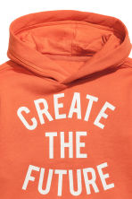 Hooded top with a print motif - Orange -  | H&M 3