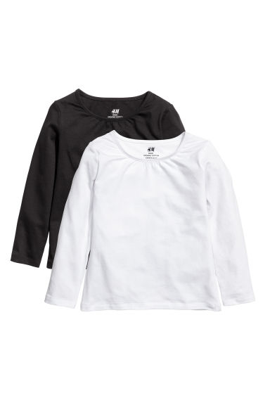 Lot de 2 tops en jersey - Blanc/noir - ENFANT | H&M BE