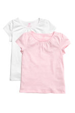 Lot de 2 tops en jersey - Rose clair chiné - ENFANT | H&M FR 1