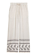 Wide trousers - Light beige/Paisley - Ladies | H&M CA 2