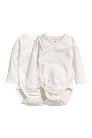 2-pack Wrapover Bodysuits - Natural white/patterned - Kids | H&M CA