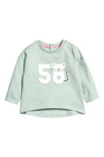 Sweatshirt with a print motif - Mint green -  | H&M 1