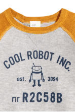 Fine-knit cotton jumper - Mustard yellow/Robot -  | H&M CN 2