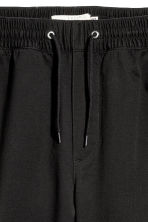 Brushed cotton twill joggers - Black - Men | H&M 3
