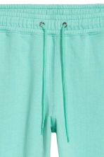 Pantaloni in felpa - Verde menta - UOMO | H&M IT 2
