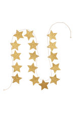 Glittery star garland - Gold-coloured - Home All | H&M GB 2