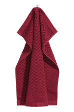 Jacquard-patterned hand towel - Dark red - Home All | H&M CN 1