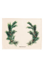 Christmas-print table mat - Natural white/Pine needles - Home All | H&M GB 1