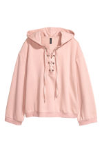 Hooded top with lacing - Light pink - Ladies | H&M CN 1