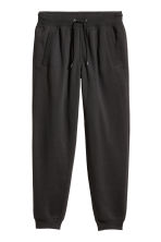Pantaloni in felpa Regular fit - Nero - UOMO | H&M IT 2