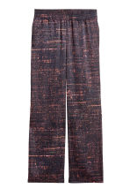 Wide satin trousers - Black/Patterned - Ladies | H&M CN 1