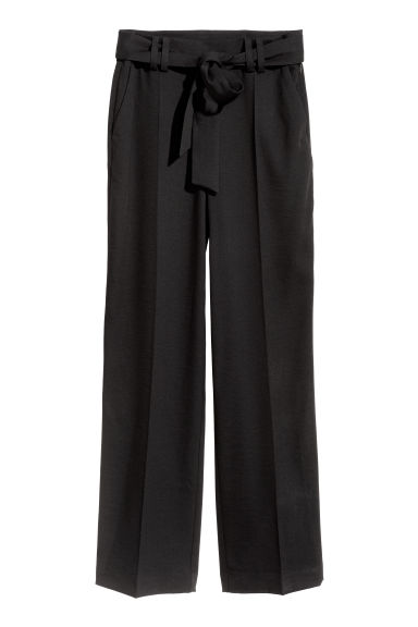 Wide trousers with a tie belt - Black - Ladies | H&M