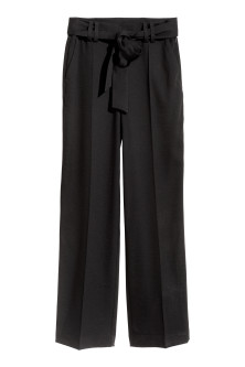 Wide trousers with a tie belt