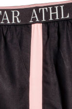 Pantaloni pull-on con bande - Nero/rosa -  | H&M IT 4