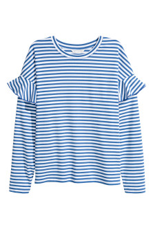 Tricot top met volants