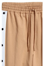 Sweatpants in a lyocell blend - Beige - Ladies | H&M IE 2