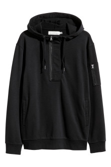 Hooded top with a zip