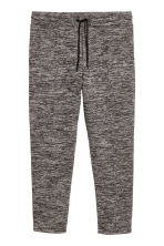 Ankle-length jersey joggers - Black marl - Men | H&M IE 2