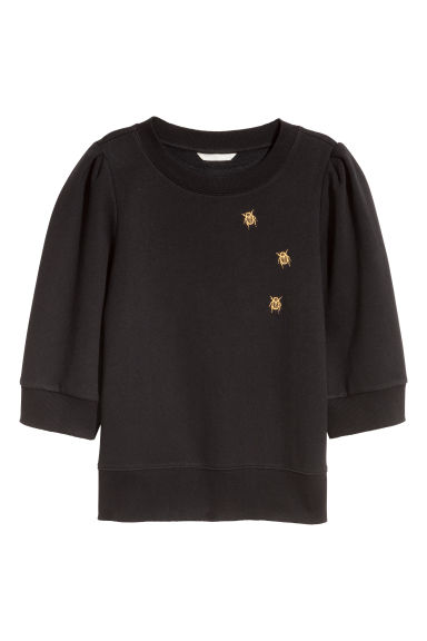 Puff-sleeved sweatshirt - Black/Beetles - Ladies | H&M IE